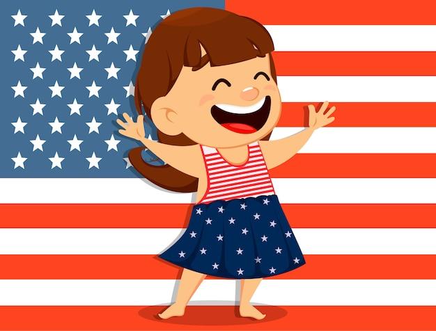 Souriant fille debout devant le drapeau américain