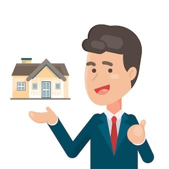 Souriant vendeur montrant une maison