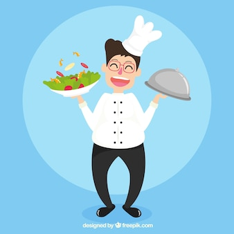 Sourire cuisinier avec salade appétissante