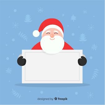 Sourire santa tenant une pancarte blanche