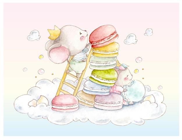 Souris aquarelle sur le nuage avec des macarons