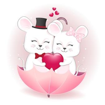 Souris de couple avec coeur dans le concept de la saint-valentin parapluie