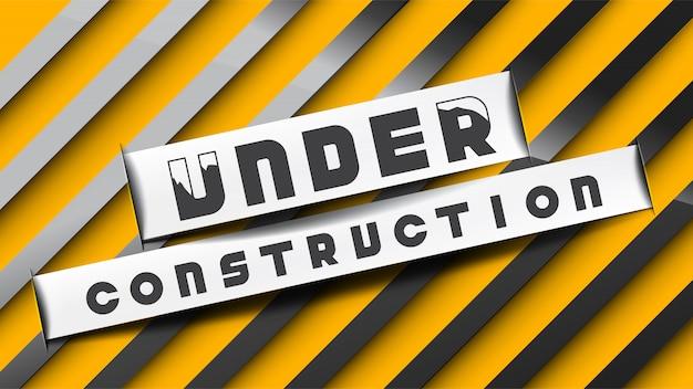 Sous construction signe papier coupé style sur des rayures noires jaunes