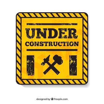 Sous le symbole jaune de construction