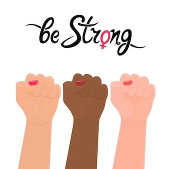 Soyez forte citation d'écriture. signe de genre féminin. poing levé. protestation, force, lutte pour les droits des femmes.