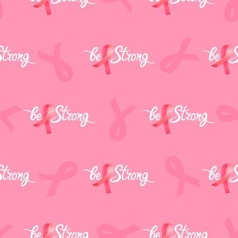 Soyez une forte inscription de motivation dessinée à la main avec un motif sans couture de ruban rose satiné. mois national de la sensibilisation au cancer du sein