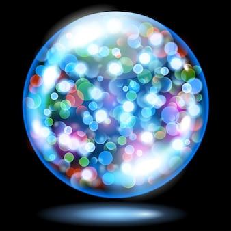 Sphère de verre bleu clair remplie d'étincelles lumineuses multicolores avec effet bokeh