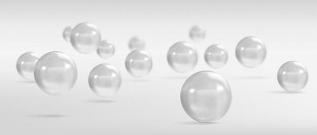 Sphères et boules sur fond gris avec une ombre.