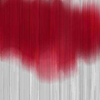 Splatters de peinture rouge sur une texture en bois