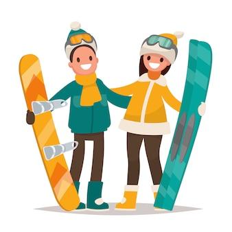 Sports d'hiver. couple homme et femme avec une planche à neige et des skis. illustration dans un style plat