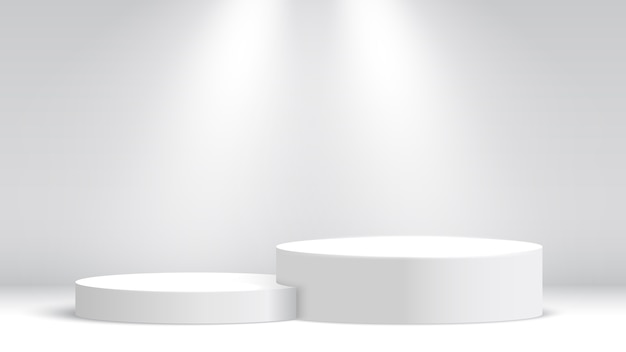 Stand d'exposition blanc. podium et projecteurs. scène pour la cérémonie de remise des prix. piédestal.