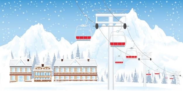 Station de ski en hiver avec montagnes et maison.