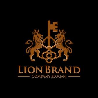 Stock de conception de luxe logo clé lion isolé sur fond noir
