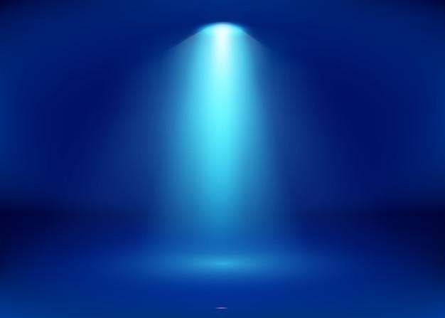 Studio bleu vide et projecteur