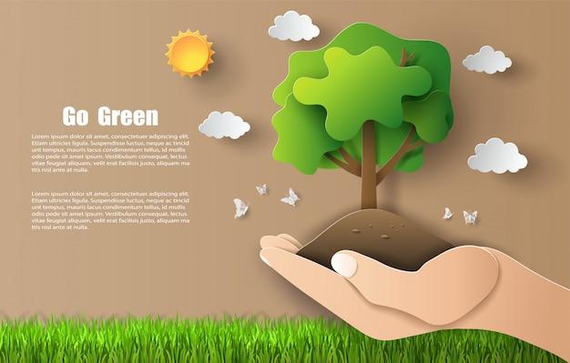 Style d'art papier de main tenant l'arbre, sauvez la planète et l'énergie.