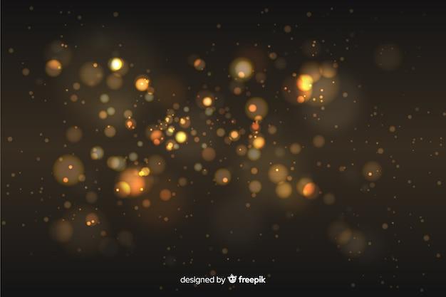 Style de bokeh de fond de particules d'or
