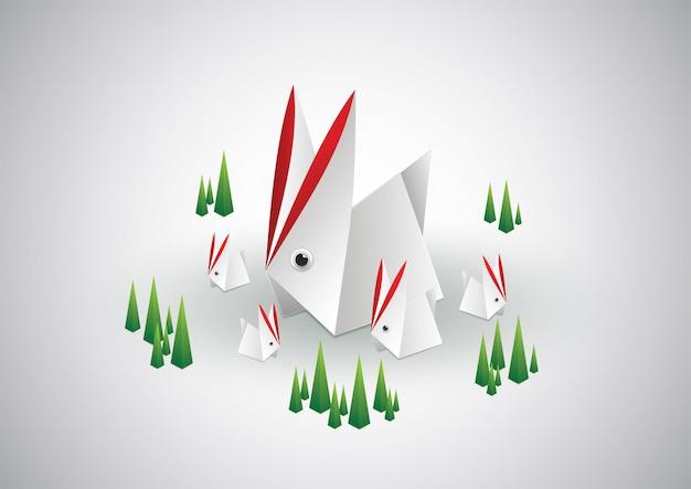 Style de famille de lapin de papier découpé.