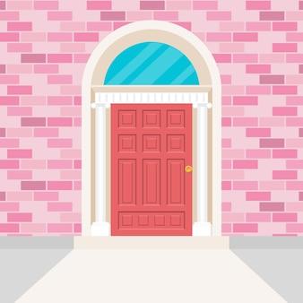 Style de porte irlandais et mur de briques de couleur rose.