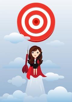 Super-héros de femme d'affaires voler et briser la cible.