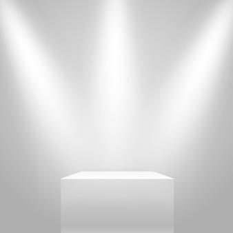 Support illuminé blanc sur le mur.
