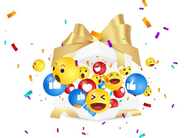 Surprenez emoji et confettis. émoticône dans une boîte cadeau surprise.