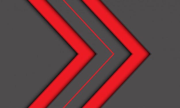 Symbole de direction abstraite jumeau flèche rouge sur fond gris.