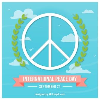 Symbole de paix avec des feuilles de laurier dans le ciel