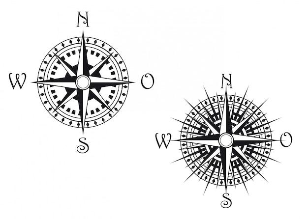 Symboles de boussole vintage isolés sur blanc pour la conception