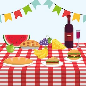 Table avec du vin et des fruits sains dans la nappe