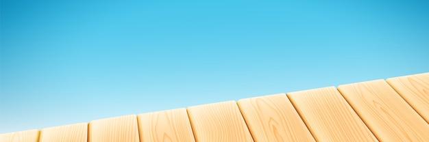 Table lumineuse en bois isolée sur fond bleu