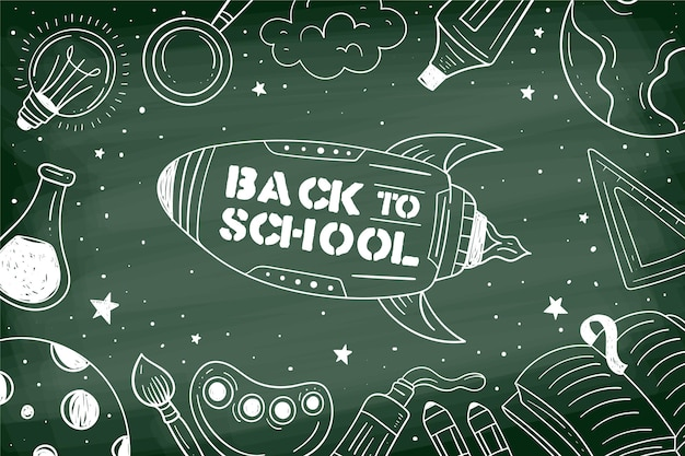 Tableau noir au fond de l'école avec des illustrations