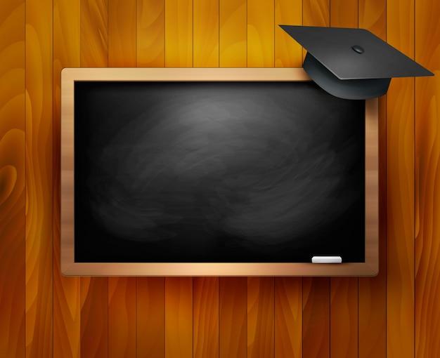Tableau noir avec capuchon de graduation.