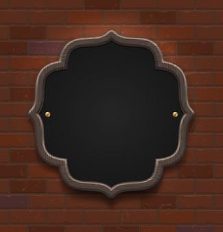 Tableau noir dans un cadre en bois sur le mur de briques vintage