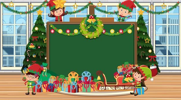 Tableau noir avec elfe de noël et cadeau