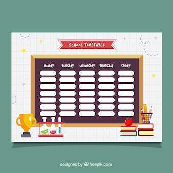 Tableau noir avec horaires et objets scolaires