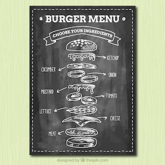 Tableau noir avec des ingrédients savoureux pour les hamburgers