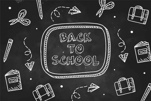 Tableau noir retour au fond de l'école avec collection d'éléments