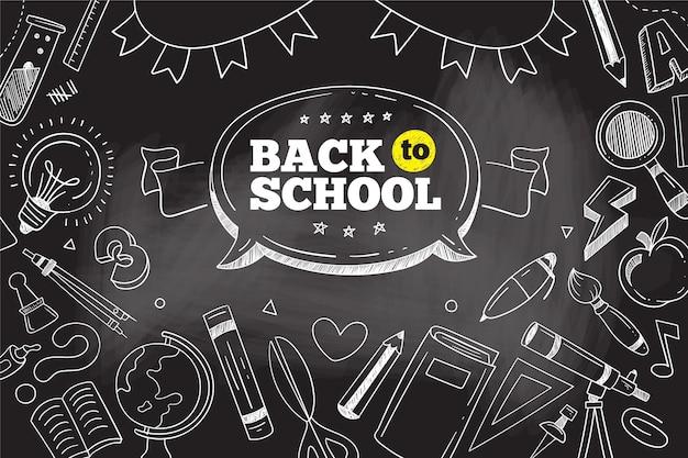 Tableau noir retour au fond de l'école avec ensemble d'éléments