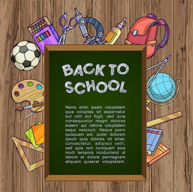Tableau vert avec fournitures scolaires - retour au concept de l'école