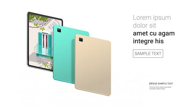 Tablette avec beau fond d'écran sur écran isolé sur mur blanc gadgets et appareils de maquette réalistes