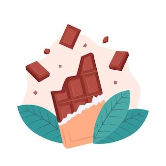 Tablette de chocolat et feuilles de fèves de cacao