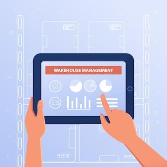 Une tablette avec système de gestion d'entrepôt.