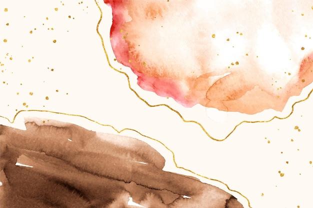 Taches d'aquarelle avec des éléments dorés