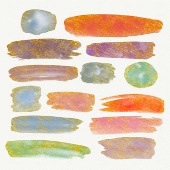 Taches d'aquarelle peintes à la main et coups de pinceau avec de l'or et des paillettes