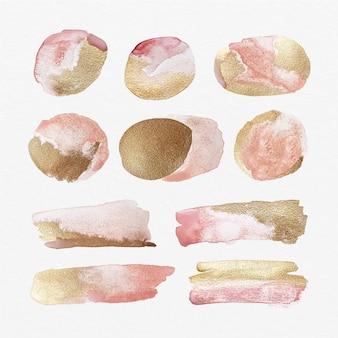 Taches d'aquarelle peintes à la main avec de l'or et des paillettes
