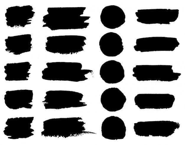 Taches de pinceau de peinture noir de vecteur