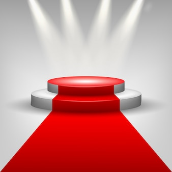Tapis rouge à la scène du podium avec des projecteurs