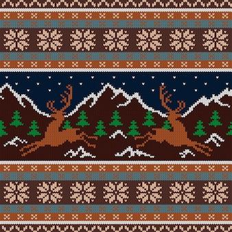 Tapisserie en laine tricotée avec des cerfs et des montagnes enneigées
