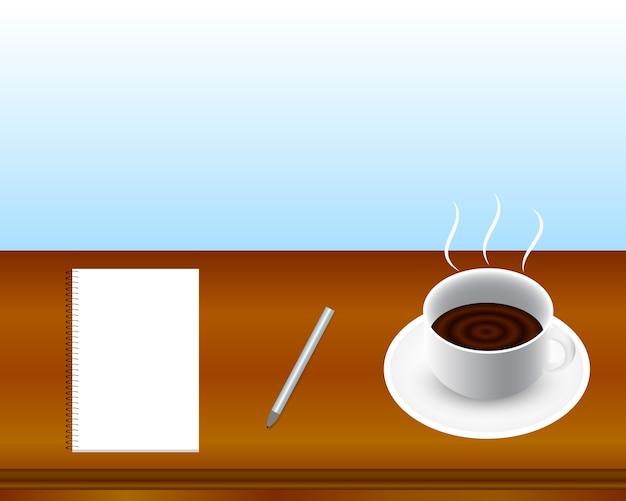 Tasse à café, cahier, stylo sur la table.