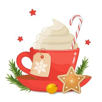 Tasse rouge avec café mousseux, cappuccino. biscuits de noël, canne en bonbon dur rayé.